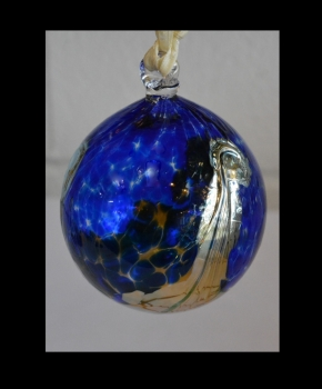 Cobalt Blue Ornament with Silver Wave Design.