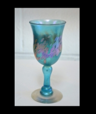 Iridescent Turquoise Wine Glass with Gold Spot Design.