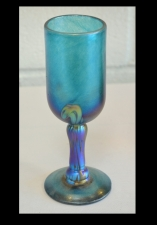 Iridescent Turquoise Wine Glass with Gold Wave Design.