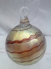 Gold Luster Ornament with Red Swirl Design