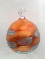 Orange Iridescent Ornament with Silver Design