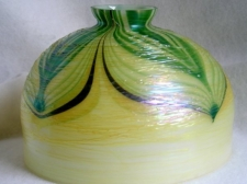 "Iridescent white 8"" dome shade with green and gold pulled feather design."