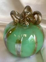 Green Pumpkin with gold Curly Stem. A collectible item