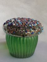 Iridescent Green Glass Cup Cake with multicolor sprinkles. Blown glass