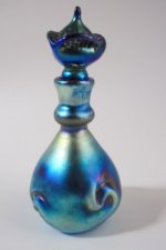 Blue luster Perfume Bottle with flower stopper. Glass art for sale.