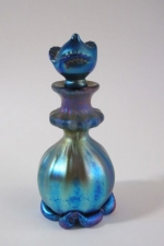 Blue luster Perfume Bottle with flower stopper. Glass art for sale.