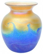 Iridescent gold vase with blue wave design. Corporate gift